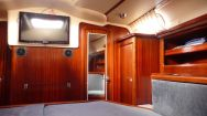 The view from the bed to the aft head the mirrored door leads there). The door to the left of the TV leads to the galley.