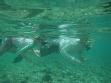 Claire and Dad, checking out the marine life in the snorkeling lagoon at Peanut Island