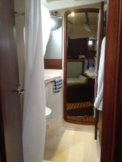 Pass-Through Shower and Head, view from the navigation station on the starboard side of the main salon