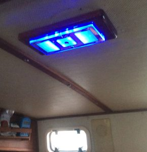 One option with LED lights is a night-vision-saving blue (or red) mode which is great for overnight passages.