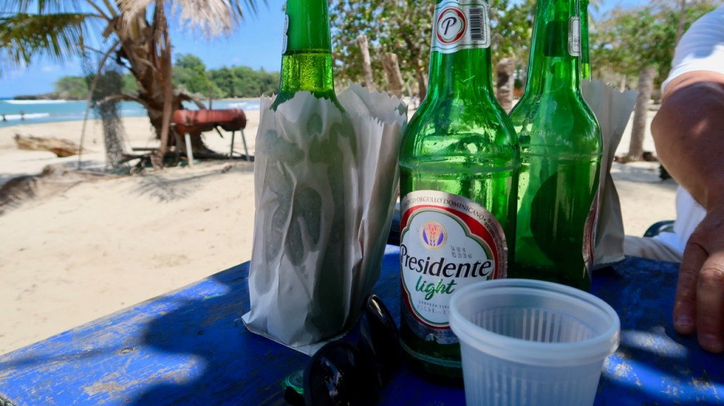 Photo of Beer Bottles on a table at the beach