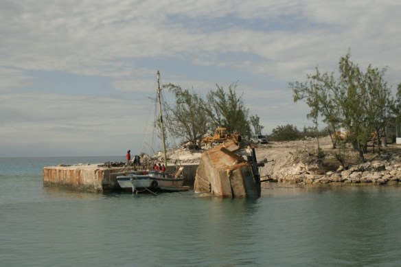Sunken wreck being hauled off to her final resting place.