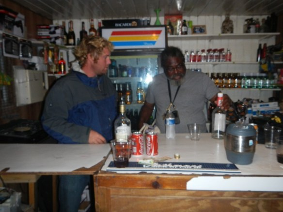 Once again, Élan makes it behind the bar... Hanging out with Ali at his bar.
