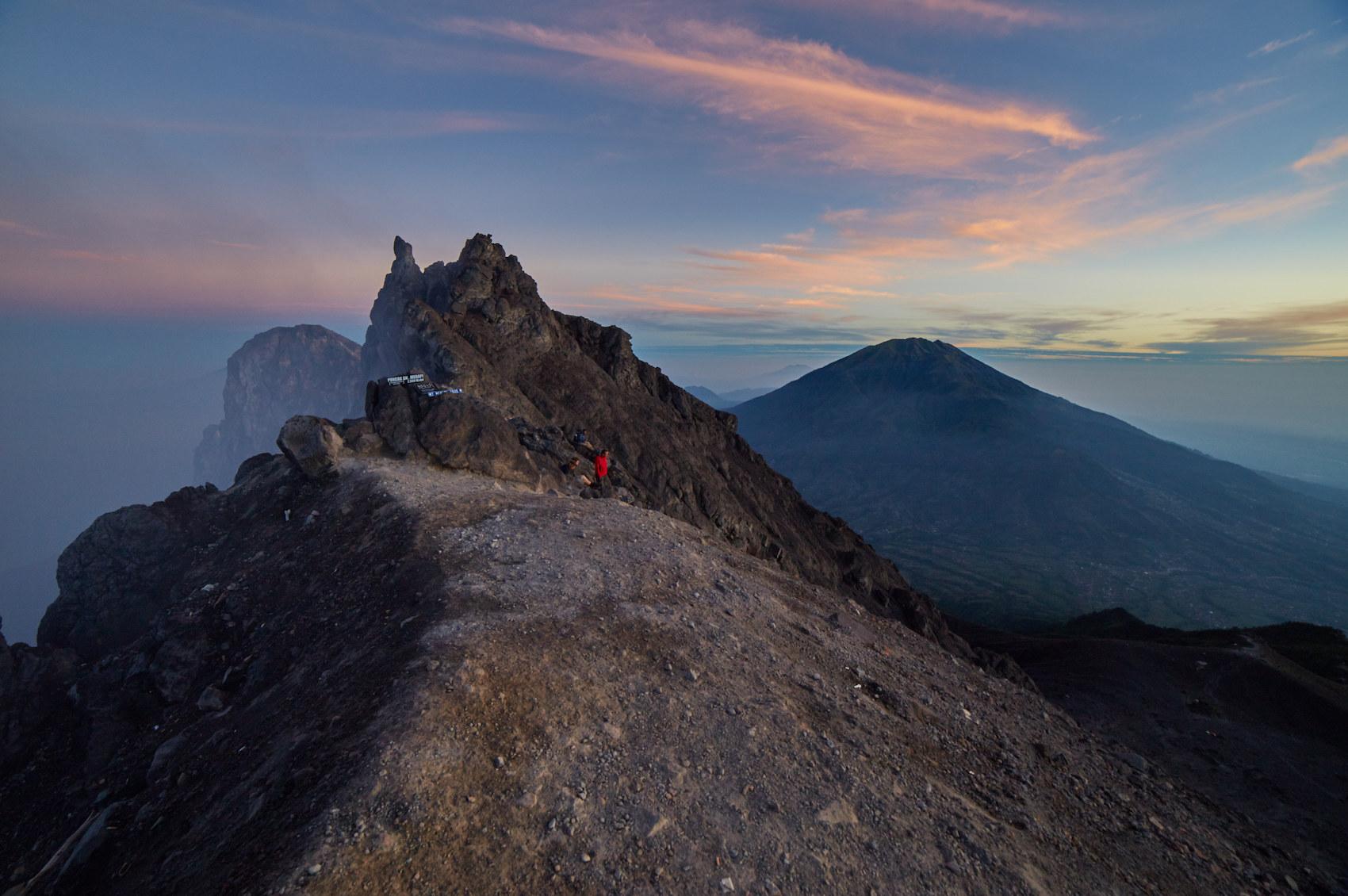 Peak of Mt. Merapi with Mt. Merbabu in Background