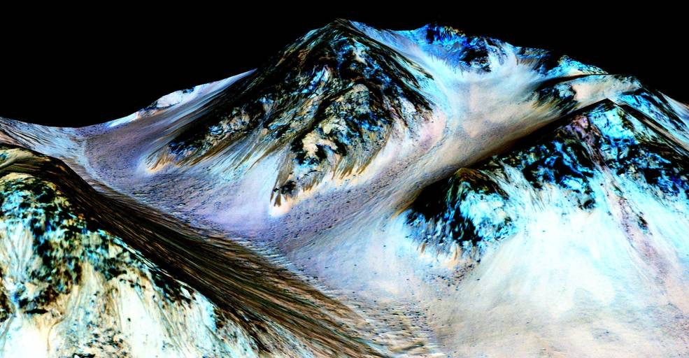 These dark, narrow, 100 meter-long streaks called recurring slope lineae flowing downhill on Mars are inferred to have been formed by contemporary flowing water. Recently, planetary scientists detected hydrated salts on these slopes at Hale crater, corroborating their original hypothesis that the streaks are indeed formed by liquid water. The blue color seen upslope of the dark streaks are thought not to be related to their formation, but instead are from the presence of the mineral pyroxene. The image is produced by draping an orthorectified (Infrared-Red-Blue/Green(IRB)) false color image (ESP_030570_1440) on a Digital Terrain Model (DTM) of the same site produced by High Resolution Imaging Science Experiment (University of Arizona). Vertical exaggeration is 1.5.