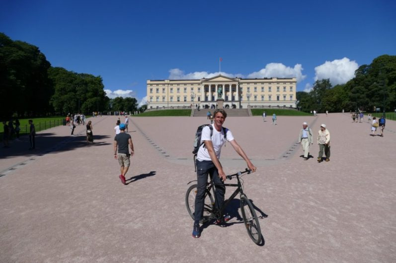 Ivar on a rental bike in front of the palace in Oslo