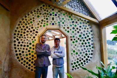 Francesco and Joaquin at the upcycled glass bottle wall