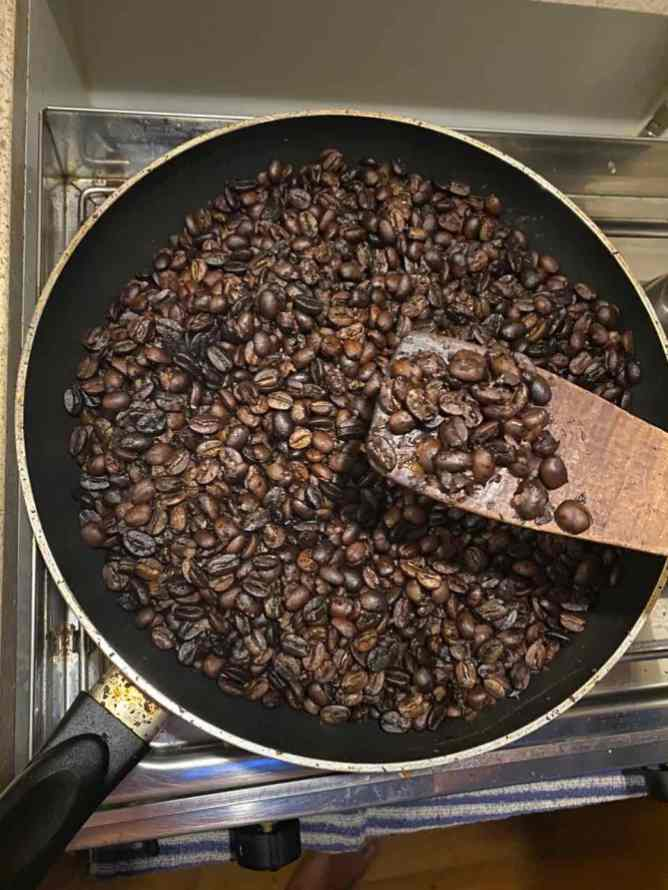 Roasting coffee beans in the frying pan