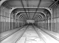 Rail car deck. To take on coal for the boilers coal cars were loaded onto the vessel then the coal was dropped through hatches visible between the rails. photo: The Engineer 16 June 1915 p. 62