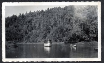 The Roamer showing the steep banks of the upper river