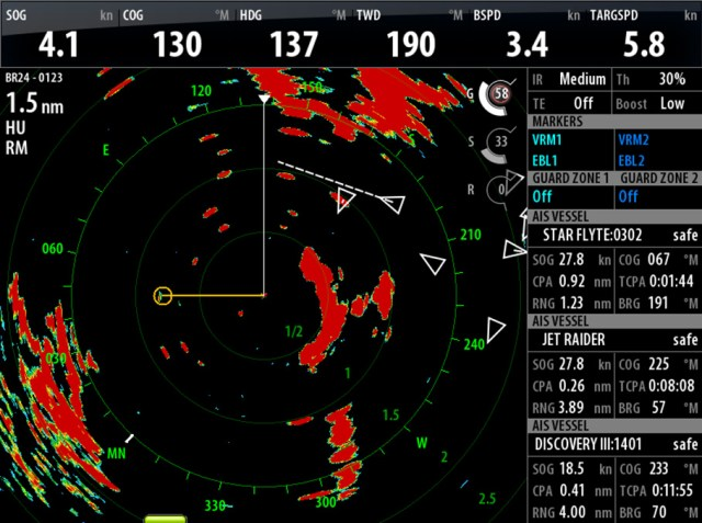 The power of AIS. This is a radar plot of what's surrounding the vessel. The triangles are the AIS signals for the other vessels in the area. The readout gives their location, course and speed and whether there is danger of a collision.