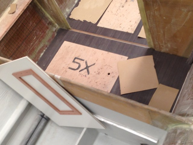 Flooring being installed in the companionway