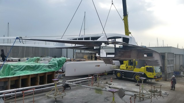 Lifting the deck over the hulls