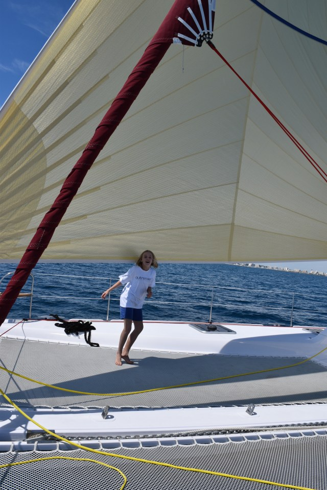Small girl, big sail!