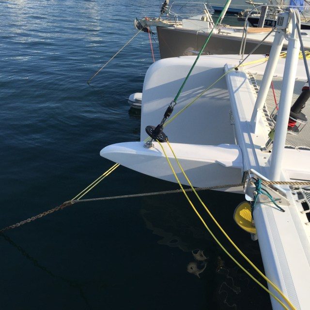 Because the mooring line is offcenter, it twists the boat to starboard, so we use a bridle line from the mooring ring to the starboard bow cleat, which pulls the bows back over to port.