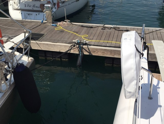 The bow mooring line is connected to a small pickup line connected to one of the dock mooring cleats