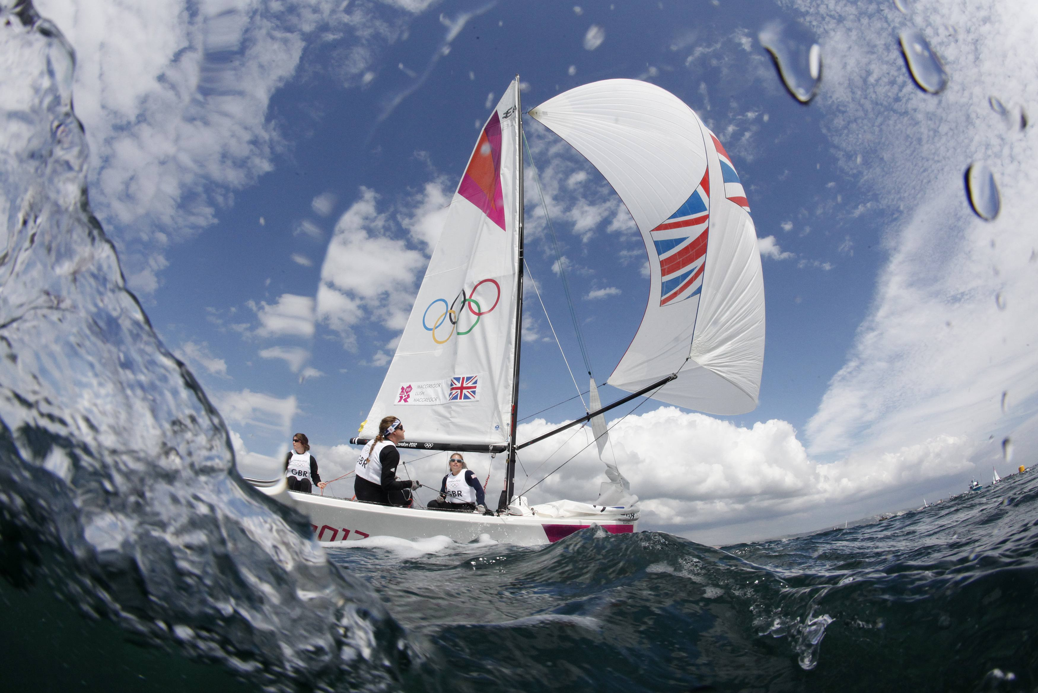 Annie Lush, Kate Macgregor and Lucy Macgregor of Britain sail in the Elliott 6m class before a practice race during the London 2012 Olympic Games in Weymouth and Portland, southern England, July 28, 2012. REUTERS/Pascal Lauener (BRITAIN - Tags: SPORT YACHTING OLYMPICS)