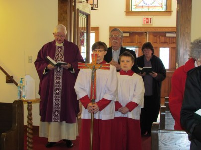 Michael (L) and James Harrison (R) prepare to lead the processional in their new vestments.