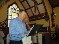 Robert Carmody signs the Book of the Elect.