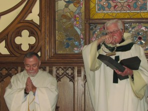 Fr. Roach reads the inscription on Tom's gift to the parish.