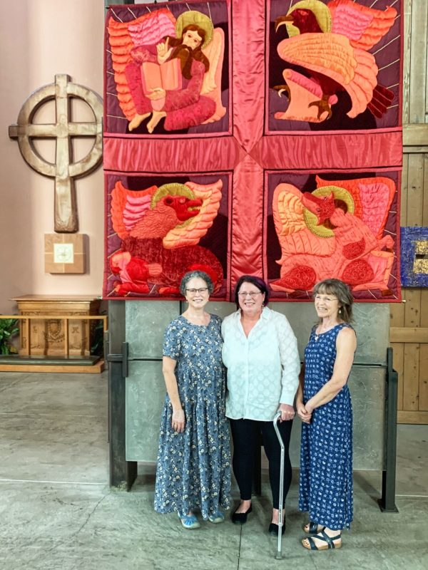 The daughters of artist Margaret Hays visited the banner, July 2021.