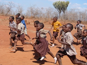 the Berega Primary School children running - just like Chrissie Fergusson doing the London Marathon when she raised money for desks and chairs for the school!