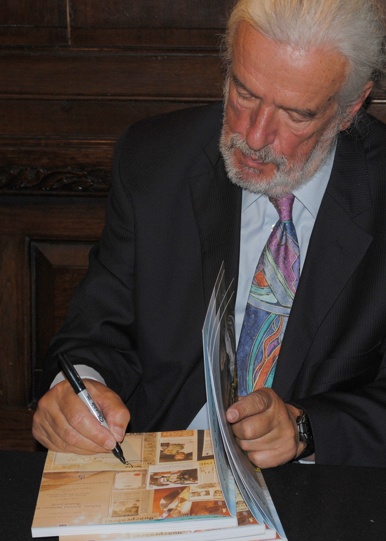 Terry McCoy signing books at the book launch - Saint Patrick's Plate