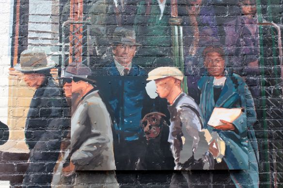 The late Senator Paul Wellstone, in the blue coat and fedora, a local activists, Prince and the famous Labrador.