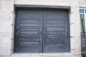 The paint on old loading dock doors show the effects of many years of wear.