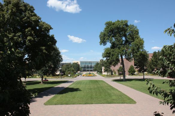 Standing on the steps of Old Main and looking north across Hewitt Avenue to Klas Center, the athletics facility, in the background.