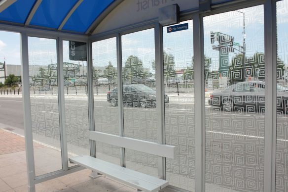 A new bus shelter at University and Prior. The two cars await the green light to turn north on Prior.