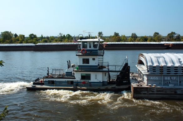 "The tug ""Mary J"" works her way upstream."