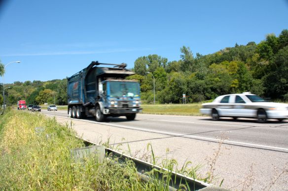 Vehicles in both lanes of Highway 61 south were traveling past me at 60-miles per hour or faster. The shoulder on which I was riding is in the foreground.