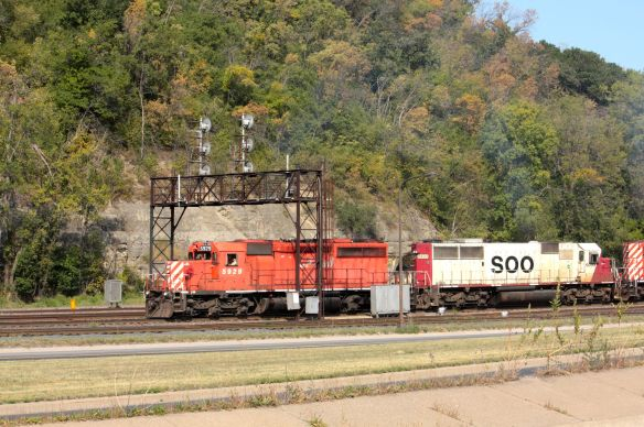 A Canadian Pacific train moves west along the Indian Mounds Park bluffs. The picture was taken from Warner Road.