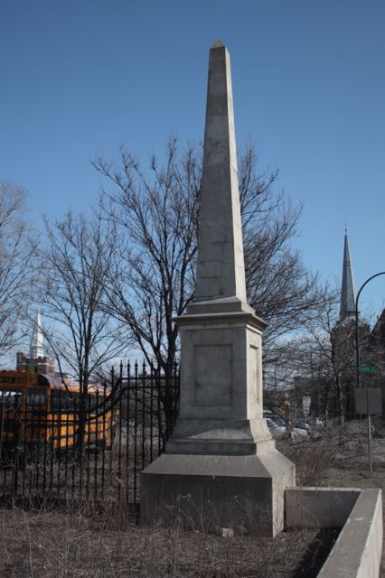 There is one of these obelisks and wrought iron fence on either side of Wacouta Street where it meets 10th. There is no marking, no plaque, no explanation of when or why these are here. My guess is that they mark the entrance to Downtown for drivers exiting 35E.)