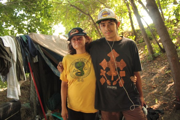 Krystal and Edgar in front of their tent on Selby Hill.