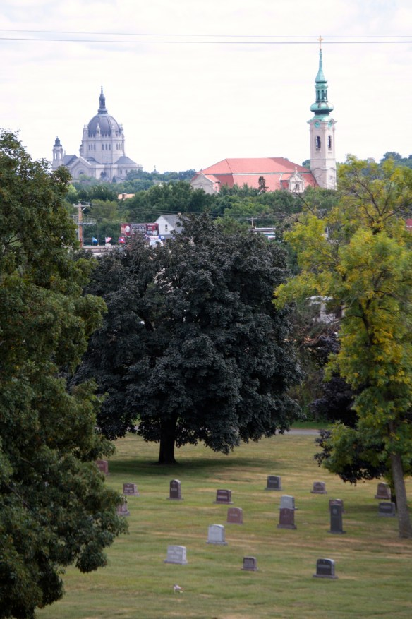 Calvary Cemetery sits atop a hill giving a magnificent view of the Cathedral of St. Paul, (left) and the Church of St. Agnes (right).