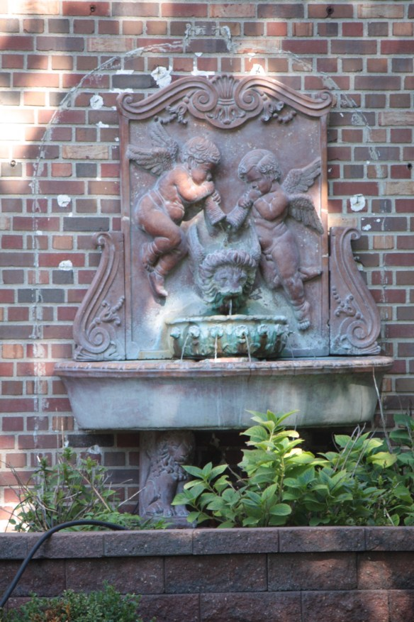 The gentle gurgling of a fountain at 6 Crocus Hill drew me to look more closely at the yard.