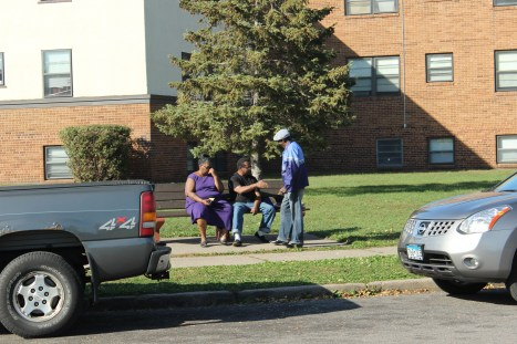 Sibley Manor residents visit outside one of the buildings.