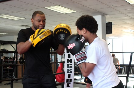 Cerresso and a young client work out in the ring.