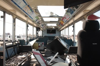 Seats and electrical parts have been salvaged from this bus.