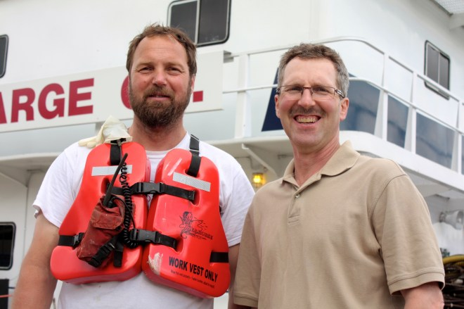 Ken Krause, left, and brother Rob stand in front of the Neil N. Diehl at Lambert's Landing.