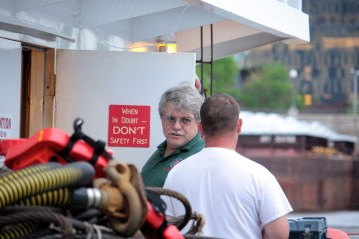Captain Lance chats with one of the crew.