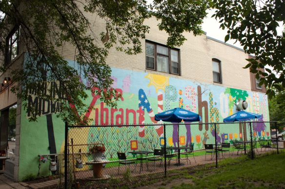 The colorful mural, a tribute to the Hamline-Midway neighborhood, decorates the west wall of Groundswell Coffee at Thomas and Hamline.