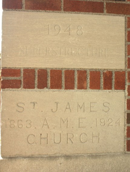 The captions on the cornerstones reflect the time at St. James' previous site (below) and completion of this building.