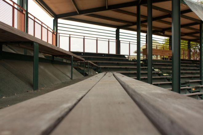 A look-see along the bleachers toward the middle of the stadium. The wood table on the right background is the press area.