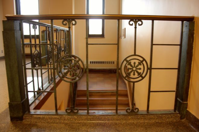 This stairway between the main floor and offices on the second floor retains most of its original style.