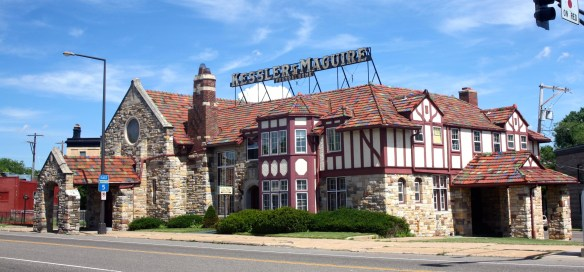 Just southwest is the Kessler & Maguire Funeral Home, which has been at St. Clair and West 7th since about 1926. That's the original neon sign on the roof of the Tudor style building.