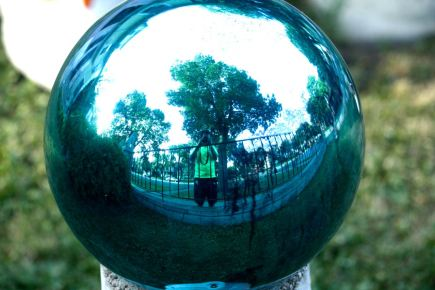 Yours truly is reflected in one of several gazing globes.