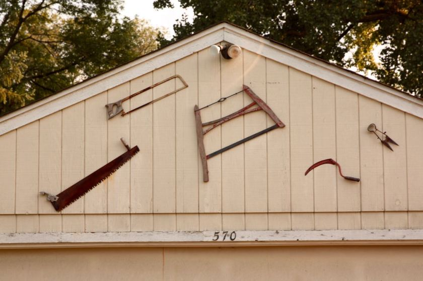 Old hand tools on the garage of 570 West Orange Avenue.